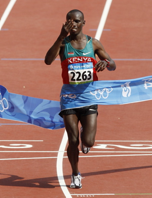 Sammy Wanjiru Crossing the Finish Line -photo Dennis Passa – AP